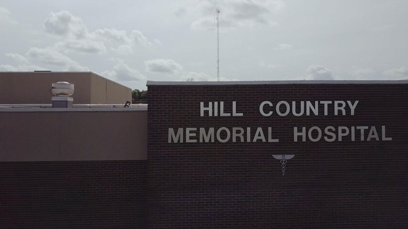Hill Country Memorial Hospital sign on building